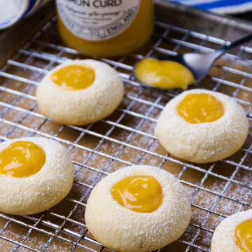 Lemon Curd in a jar with a spoon to fill cookies