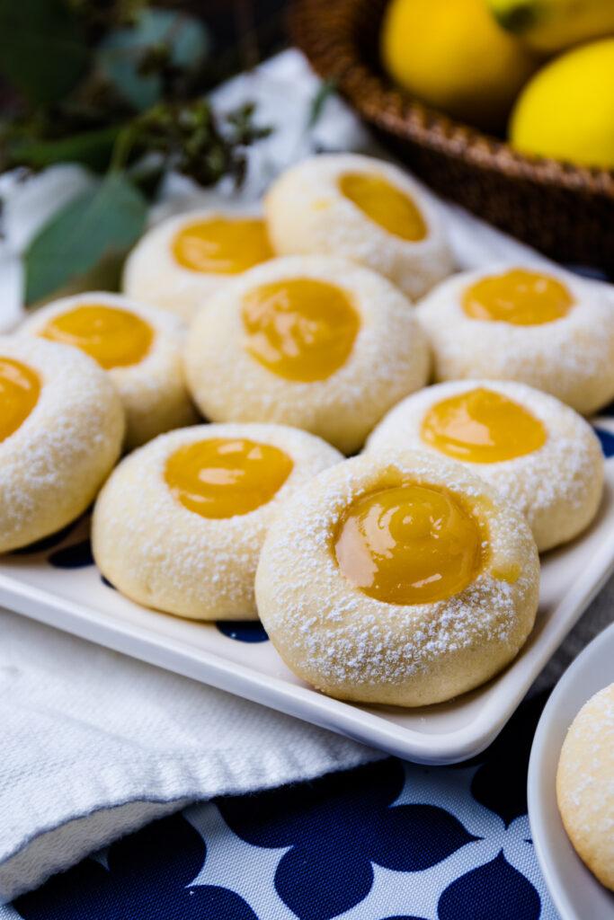 Lemon Curd Thumbprint Cookies on a plate for dessert.