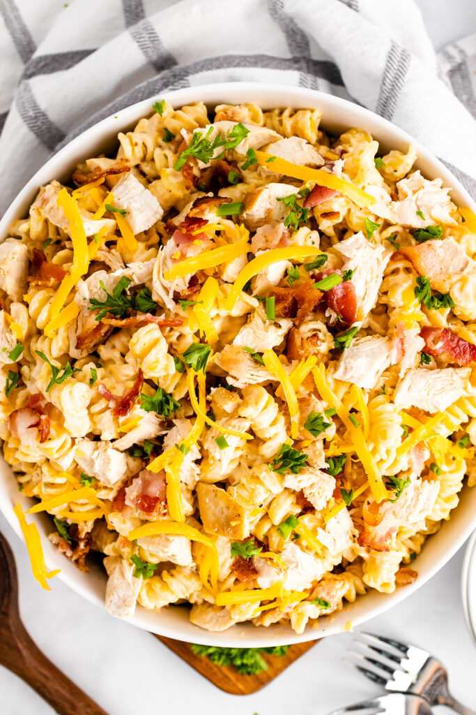 White bowl full full of Chicken Bacon Ranch Pasta for a crowd.