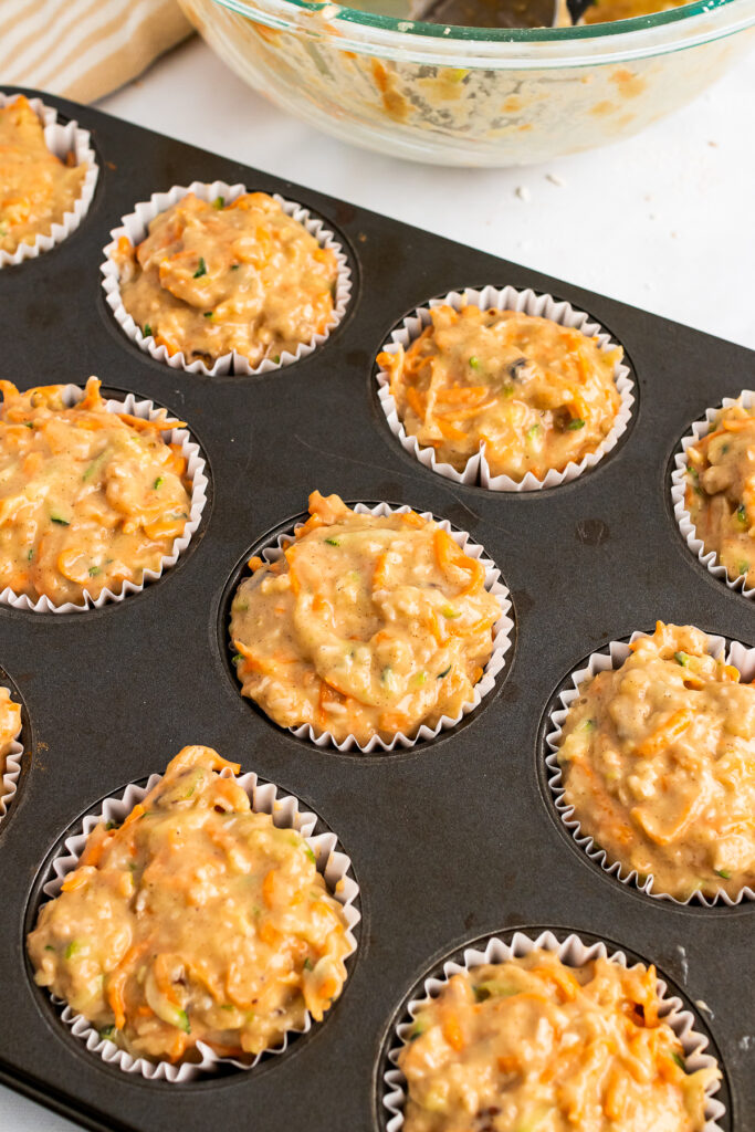 Muffin Pan filled with liners and Morning Glory Muffin dough.
