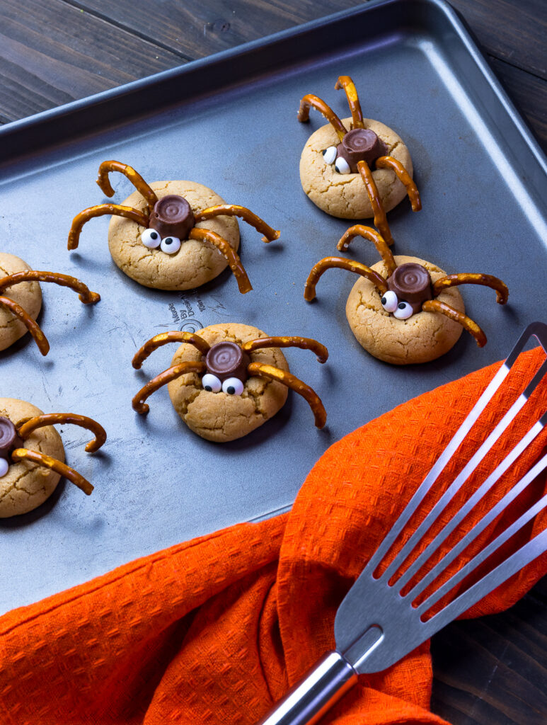 Baked spider cookies with an orange napkin