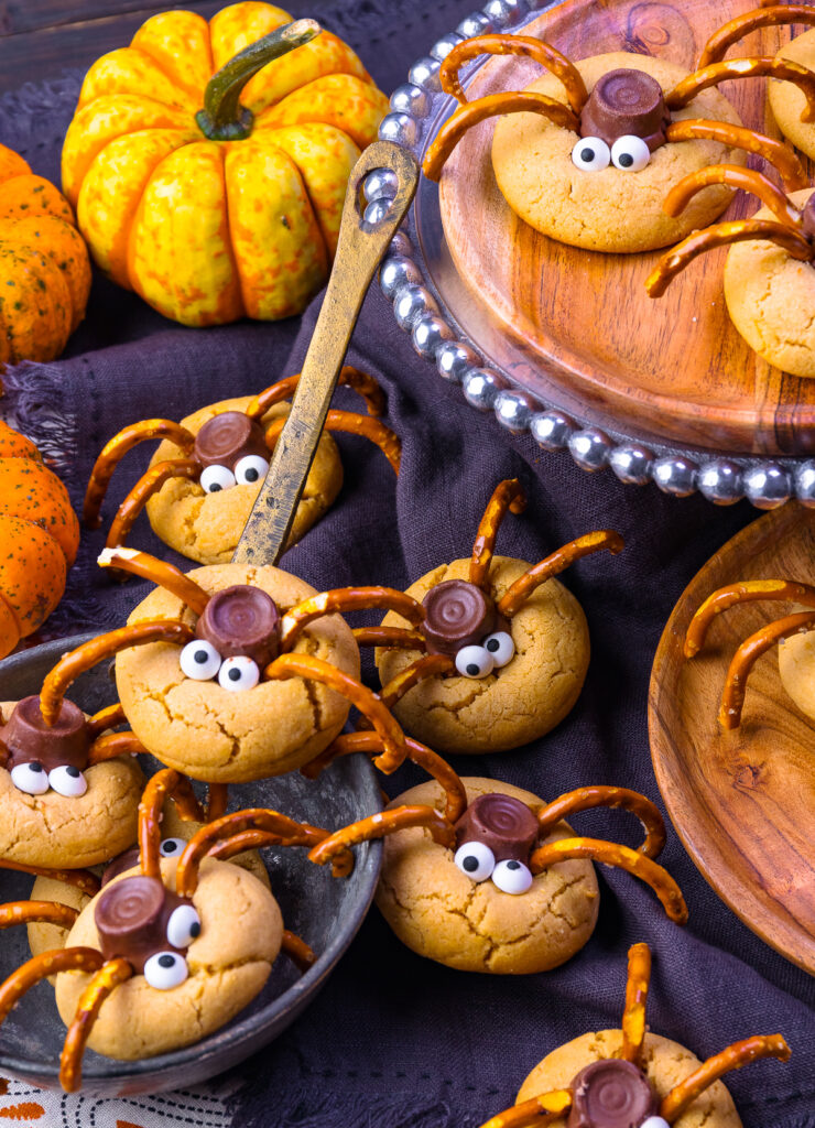 Spider Cookies on a black napkin with pumpkins