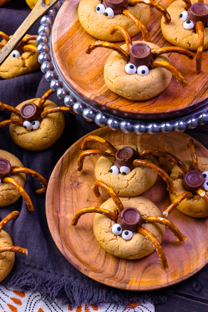 Spider Cookies on a wooden plate.